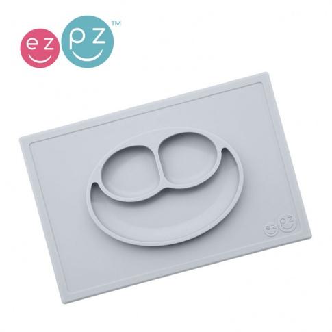 Fotografia, na której jest EZPZ Silikonowy talerzyk z podkładką 2w1 Happy Mat pastelowa szarość