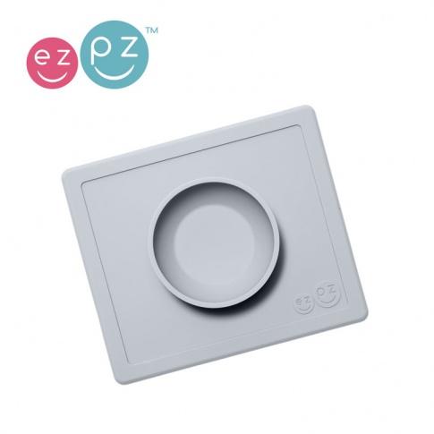 Fotografia, na której jest EZPZ Silikonowa miseczka z podkładką 2w1 Happy Bowl pastelowa szarość