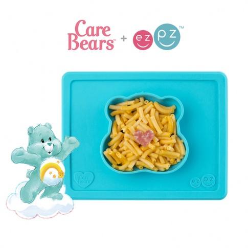 Fotografia, na której jest EZPZ Silikonowa miseczka z podkładką 2w1 Care Bears™ Bowl Misia Życzliwe Serce Wish Bear turkusowa