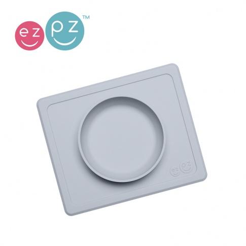 Fotografia, na której jest EZPZ Silikonowa miseczka z podkładką 2w1 Mini Bowl pastelowa szarość
