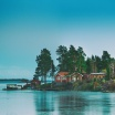 Fotografia, na której jest Fototapeta REBEL WALLS | SCANDINAVIA Cottage Island